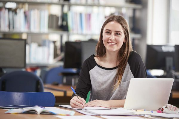 portrait-of-female-student-working-at-laptop-in-co-P5GWU9L.jpg